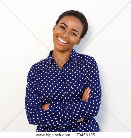 Smiling Woman In Polkadot Shirt Standing Against White Background