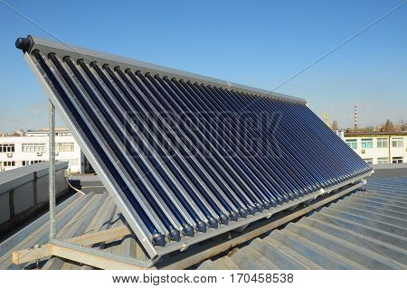 Solar water heating (SWH) systems use solar panels called collectors fitted to your roof. Energy efficiency concept. Solar Hot water panels heating.