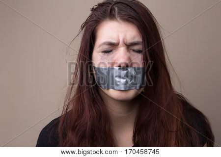 Brunette with tape on face