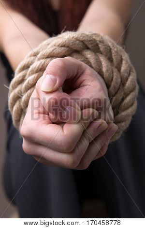 Blindfolded hands woman with rope