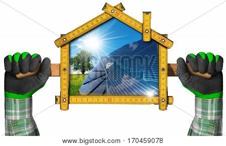 Hands with work gloves holding a wooden meter ruler in the shape of house with a solar panel and sun rays inside. Concept of ecological house project