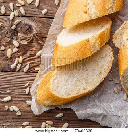 Picture of baguette on table with seeds