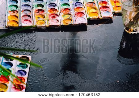 The paint went on wet black surface beautiful background creativity