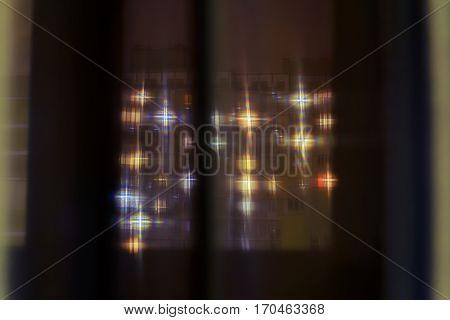 Building Lights Seen Through A Curtain