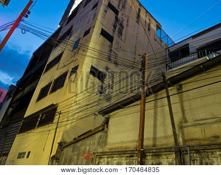 Building in secluded alley in night time