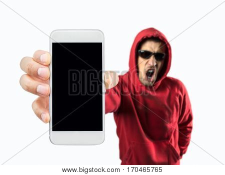 criminal hacker showing the smartphone which is pirated on white background