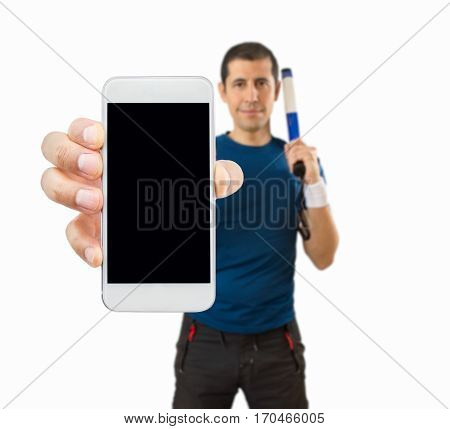 happy sportman showing the smartphone on white background