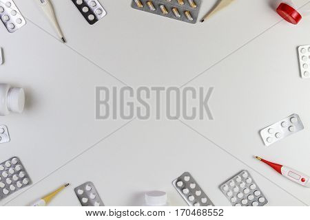 Vitamins, supplements, tablets pils, thermometers on white background. Top view. Copy space for text