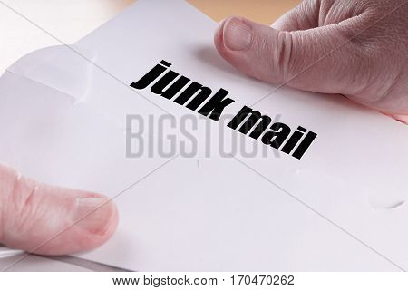 hands opening junk mail or direct mailing letter