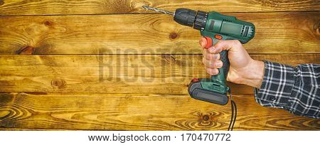 Drill in man's hand on white background