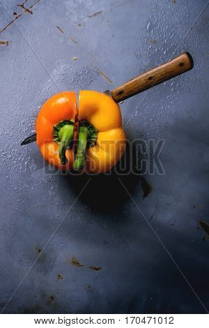 Two halves of paprika on steel background