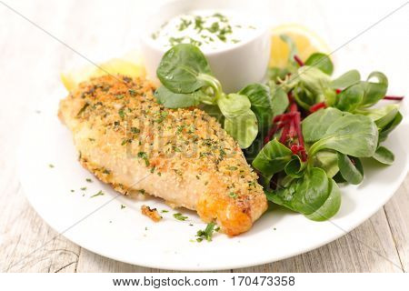 chicken breast with crumbs and sauce