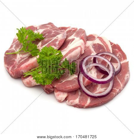 Raw pork neck chop meat with parsley herb leaves and onion slices garnish isolated on white background cutout