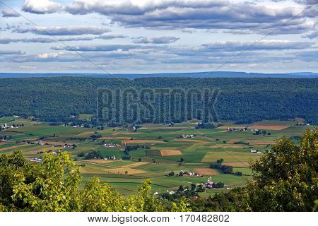A mountain top view of farmland in the Kishacoquillas Valley of Mifflin County Pennsylvania United States.