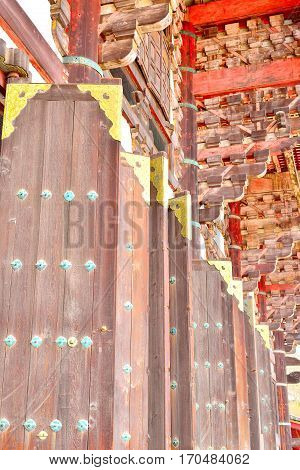 Large wooden doors with golden decorations Todaiji Nara Japan.