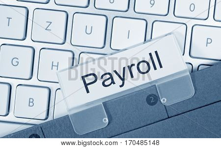 Payroll - folder with text on computer keyboard
