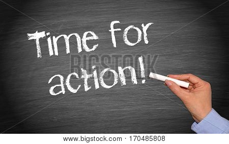 Time for action - female hand writing text on blackboard