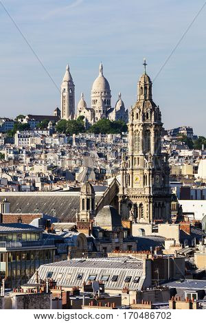 Panorama of Paris: The Sainte-Trinite and Sacre-Coeur churches.View of Paris from the rooftop of building into the summer sunset. Paris France
