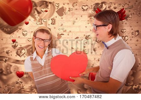 Geeky hipster offering red heart to his girlfriend against love heart pattern