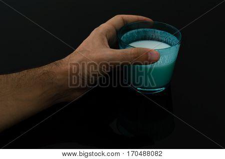 Man hand holding a glass of kefir