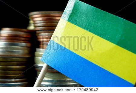 Gabon Flag Waving With Stack Of Money Coins Macro