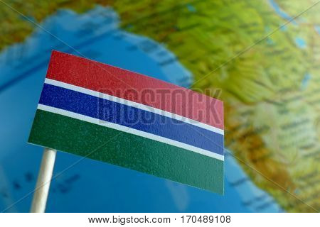 Gambian Flag With A Globe Map As A Background Macro
