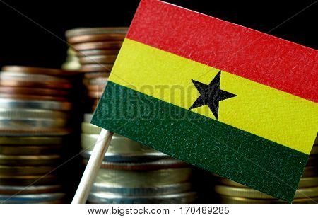 Ghana Flag Waving With Stack Of Money Coins Macro