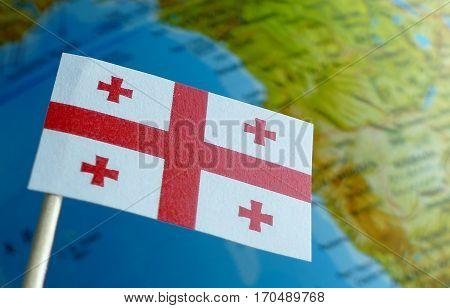 Georgian Flag With A Globe Map As A Background Macro