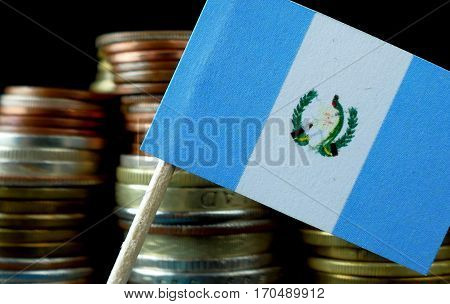 Guatemalan Flag Waving With Stack Of Money Coins Macro