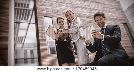 Portrait of Businesspeople using laptop and digital tablet