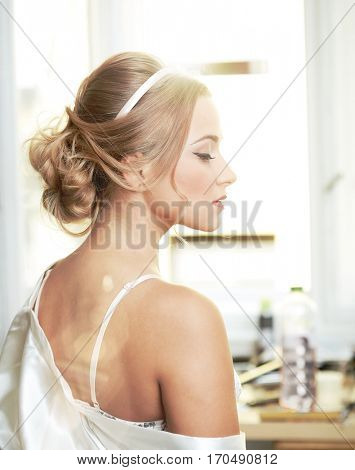 Side view of beautiful sensual young bride.