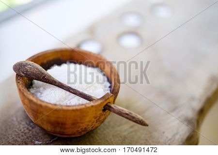 Bath salt in a wooden bowl in spa