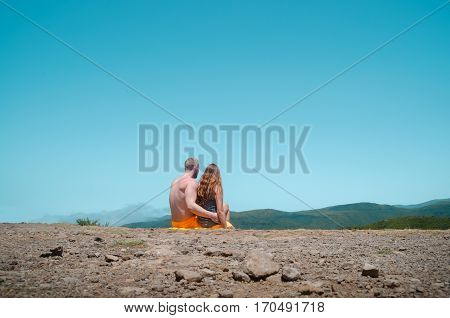 Love couple on top of mountain with blue sky on valentines day, madeira portugal