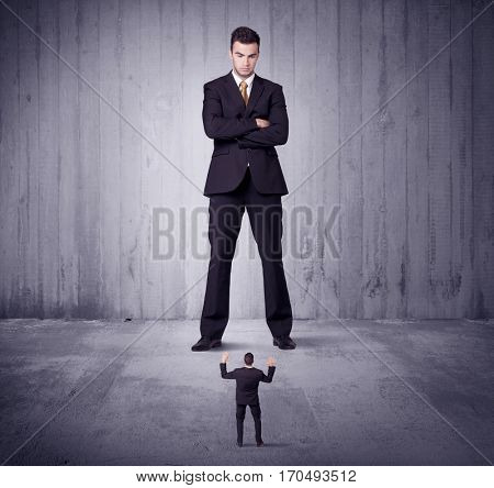 Huge boss manager lokking at small business man concept on background