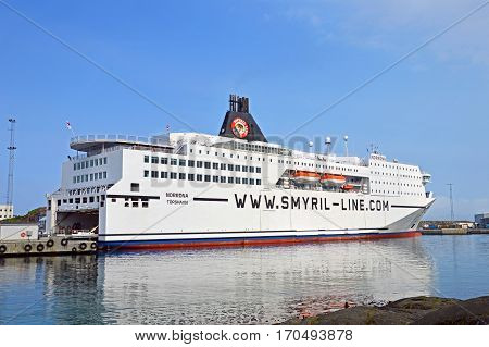 Torshavn, Faroe Islands - June 5, 2014: The ferry ship Norrona from Smyril Line has moored at the ferry terminal in Torshavn.
