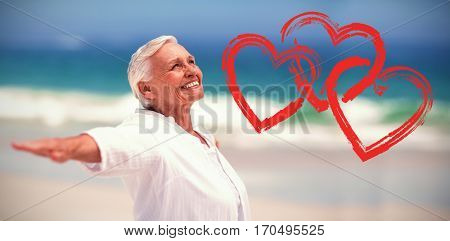 Print against side view of mature woman posing with arms outstretched