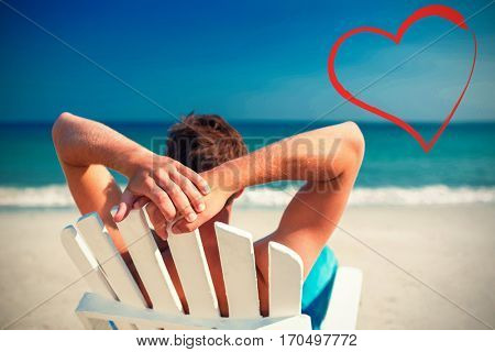 man relaxing on deck chair at the beach