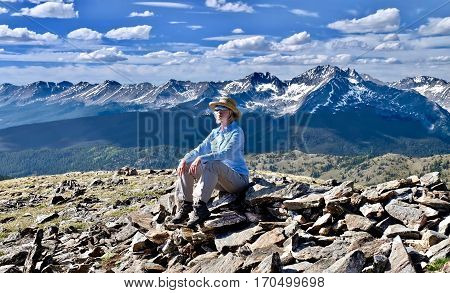Woman hiking in mountains. Scenic view from Independence Pass near Aspen. Denver. Boulder. Colorado. United States.