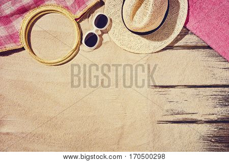 Top view of sandy beach frame. Background with copy space and visible sand texture.