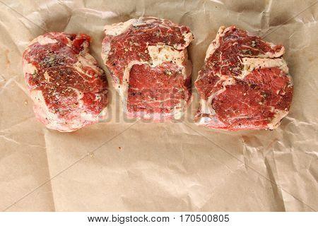Raw Rib eye steak with spices.