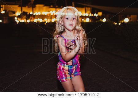 Little girl dancing and having fun. Summer night. Happy child. Motion photo. Natural Beauty.