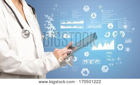 Female doctor holding tablet with blue background and data graphics