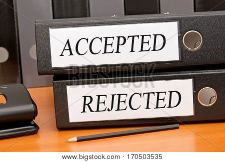Accepted and Rejected - two binders on desk in the office