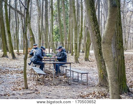 MOSCOW, RUSSIA - APRIL 10, 2015: Pensioners are playing chess in Tsaritsyno Park in Moscow