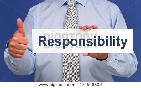 Responsibility - Businessman with sign and thumb up