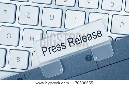 Press Release - folder with text on computer keyboard