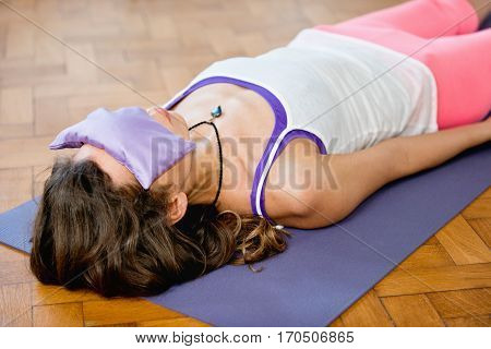 Savasana or corpse position in Yoga, horizontal image