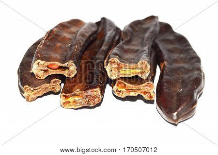 Pictures of natural dried carob on a white background