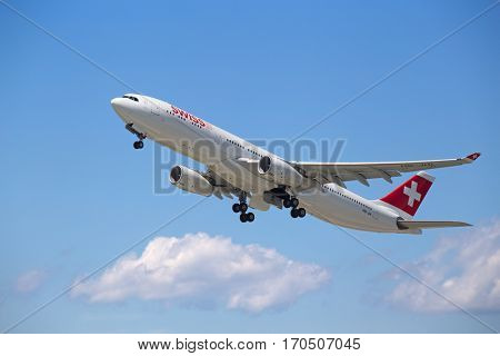 ZURICH - July 30:  Swiss A-330 Taking off at Zurich Airport on July 30, 2016 in Zurich, Switzerland. Zurich airport is home port for Swiss Air and one of the european hubs.