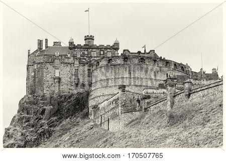 Edinburgh Castle in Scotland, processed to look like a vintage sepia photo or postcard.